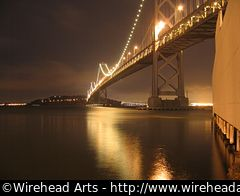 The San Francisco Bay Bridge at night, taken from the Embarcadero.