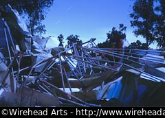 The destroyed fragments of a radio telescope with a ghost.