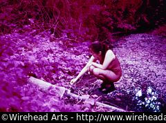Dona playing in the creek, with the funky colors from Ektachrome IR color infrared film.